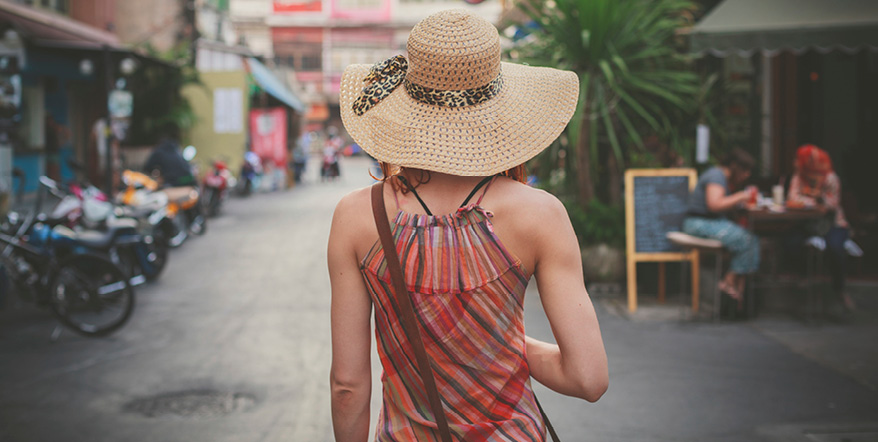 Image of woman in a hat on vacation.