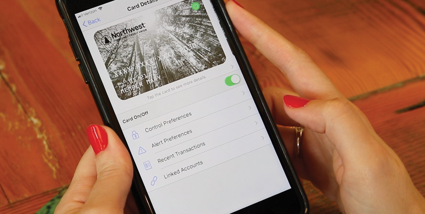 Image of woman holding iPhone with CardValet app screen up.